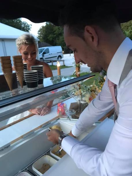 groom serving ice cream on wedding day
